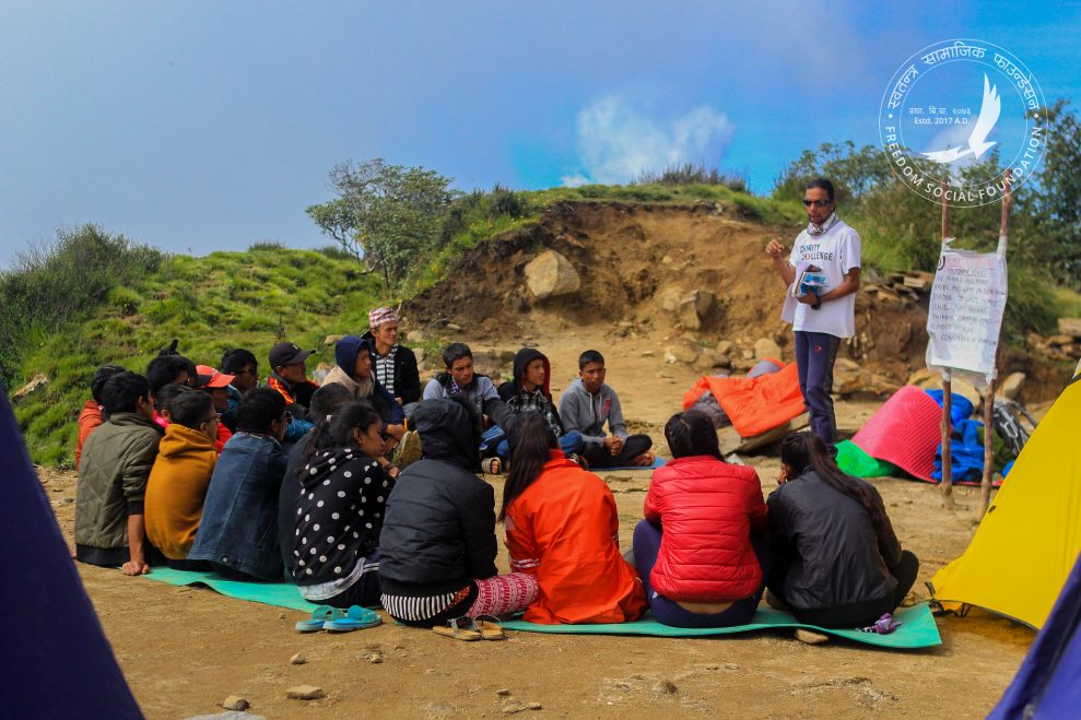 Jagan Teaching Students outside at Mardi Himal Base Camp, Freedom Social Foundation